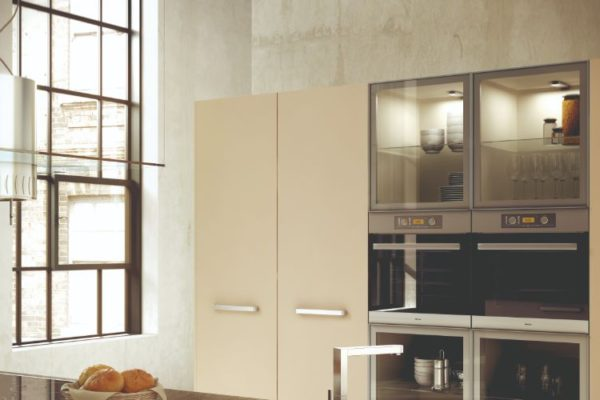 Neat kitchen with vertical cabinets
