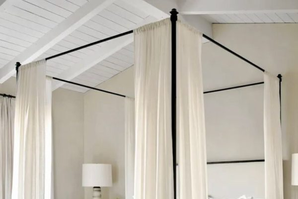 White curtains metal rod beds