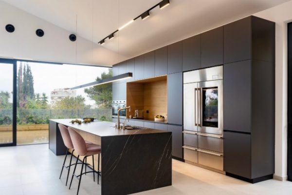 Modern kitchen with black coloured cabinets