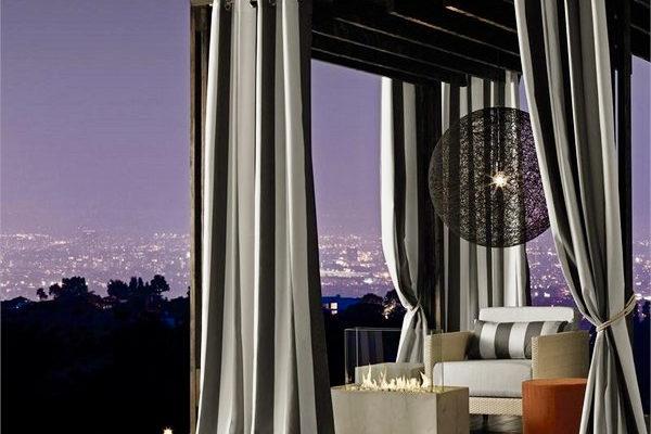 Exquisite pergola with black and white curtains