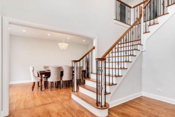 Wooden top staircase vertical railings