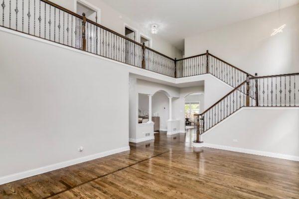 Vertical railings wooden staircase