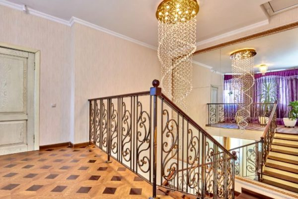 Golden staircase spiral railings