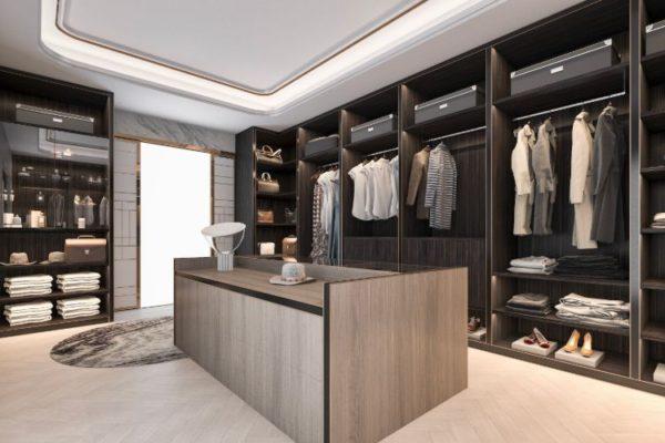 Brown floor, rectangular sized cabinets walk in closet