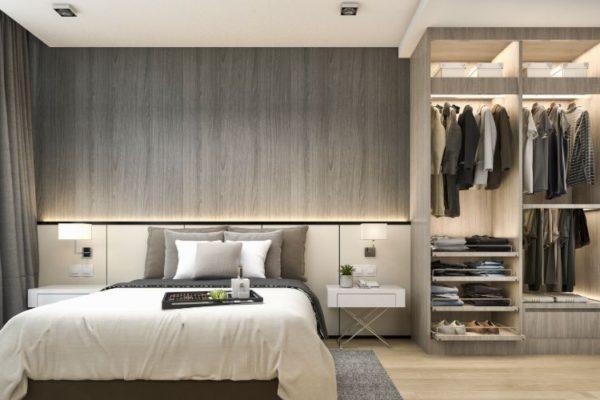 Gray wardrobe near bed