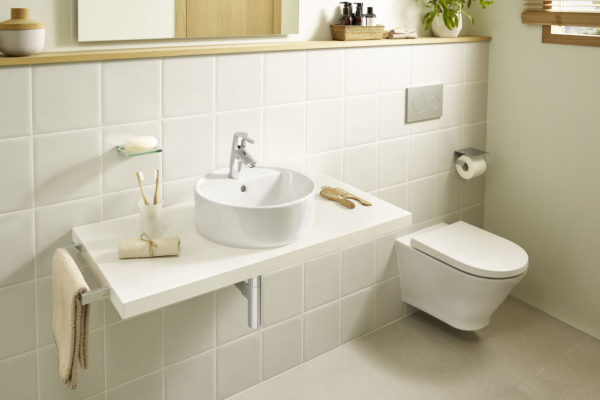 ROUND - Wall-hung toilet with horizontal outlet and concealed fixings
