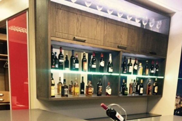 Modern design kitchen top with shelves full of wine