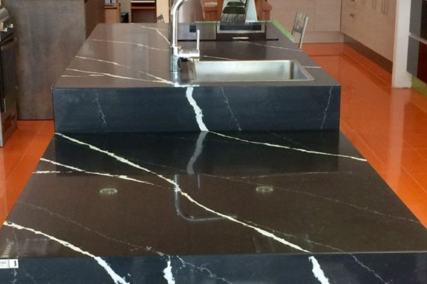 Polished marble streaked kitchen top with sink