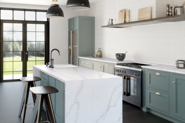 Neat kitchen top with sink and two wooden dining seats