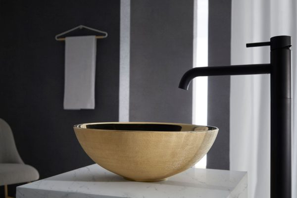Black stainless steel tap and caramel brown basin