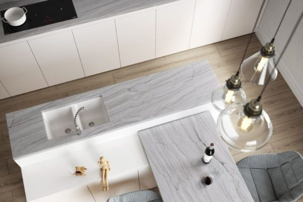 Marble kitchen top with low hanging pendnant lights