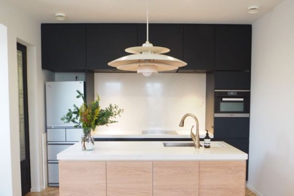 Modern cool kitchen top design with low hanging light and sink.