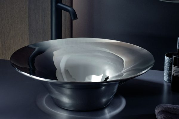 Stainless steel basin with black tap
