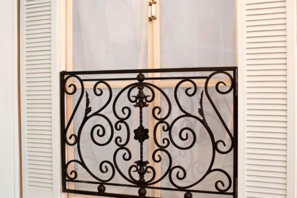 Open window balcony floral railings