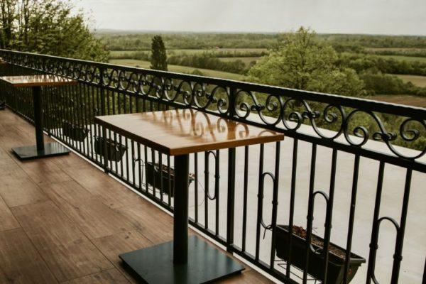Open field balcony with vertical railings