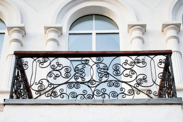 Second story balcony with floral black railings
