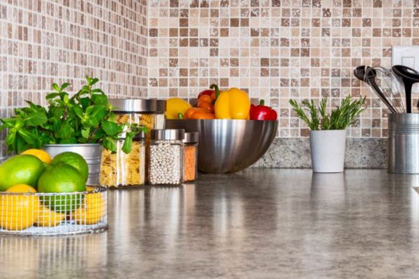 Clear kitchen top with stainless steel containers with food