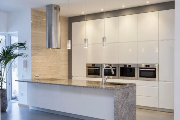 Polished kitchen top with sink and hanging lights