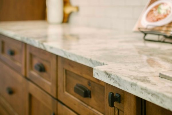 Marble white kitchen top with fronted wooden drawers