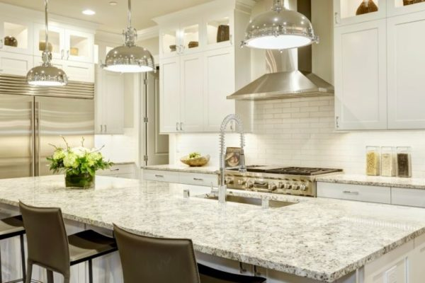 Marble kitchen top with dining seats and kitchen sink