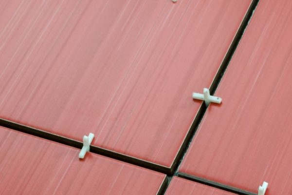 white x shaped tile spacers