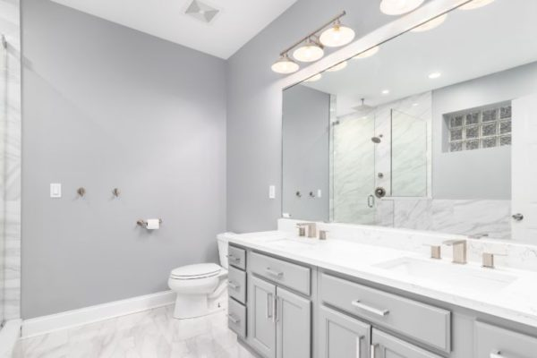 Polished white luxurious bathroom with multi cabinets